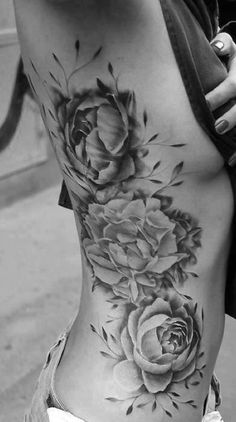 Black and white rose tattoo// love the placement