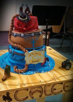 I made this cake for my nieces 16th birthday and it traveled 8 hours to the party!! All pieces are made of fondant including the camera and boot. I also made the table/cake stand and personalized it with her name and other things around the base. The second tier is supposed to look like her favorite purse. The jean tier is a skirt because she doesn't wear pants at all.