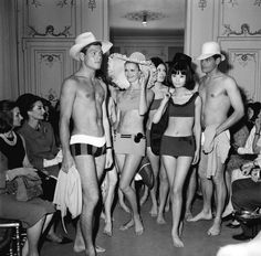 The Pierre Cardin swimsuit collection, model Hiroko in center and Vicomtesse Jacqueline de Ribes is seen sitting 2nd from left, Paris, April, 1963