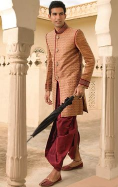 Sherwani -A coat-like garment buttoned in the front which reaches down to the knees or lower. Usually has embroidery or some other type of work on it. (Rudrakshi Johar FMM1B2)