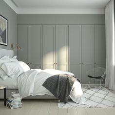 Cozy bedroom with A.S.Helsingö wardrobe. ENSIÖ wardrobe doors on IKEA PAX cabinet frames. PARASOL handles in copper.