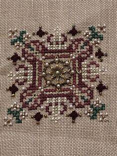 Here is a counted Cross Stitch 3 inch square design with pearl and glass bead embellishments. It is on a linen cloth ready for framing. Cross Stitch Needles, Scary Halloween, Nightmare Before Christmas, Bohemian Rug, Embellishments, Glass Beads, Handmade Items, Weaving, Disney