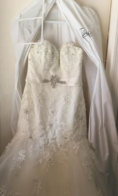 Cosmobella 7521: buy this dress for a fraction of the salon price on PreOwnedWeddingDresses.com