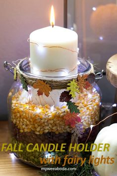 This DIY autumn candle holder can be done in minutes and will be perfect for your fall decor and diy. With just a few items, you can make this unique pillar candle holder using fall grains and fairy lights. #myweeabode #falldiy #diydecor #easycenterpiece