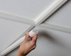 trim for a suspended ceiling! I have always HATED the look of dropped ceilings! This could change everything..
