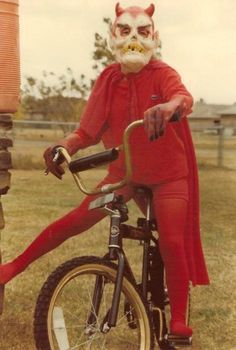 Devil rides a BMX bike