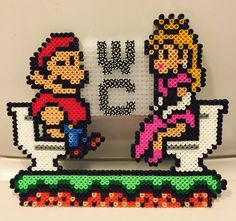 Perler Super Mario and Princess Peach toilet sign.