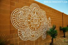 Design painted on a block wall. They used an overhead projector and traced over the design.