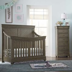 The Bassett Baby® Premier Parker Convertible Crib in Cobblestone is designed with rustic charm and traditional styling to create a splendid nursery room. This refined Louis Phillippe inspired nursery room is designed with fine details such as bold Baby Nursery Themes, Baby Nursery Furniture, Nursery Room Decor, Baby Boy Nurseries, Nursery Ideas, Girl Cribs, Baby Cribs, Brown Crib, Modern Crib