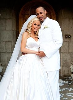 Kendra Wilkinson and Hank Baskett.  The couple wed at the Playboy Mansion and later welcomed son Hank IV on Dec. 11, 2009.