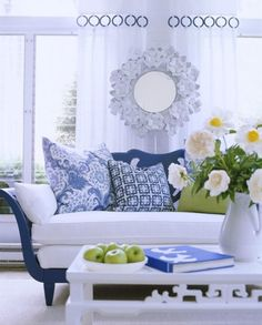 High white drapes on a royal blue background makes the room look