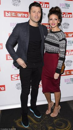 Keeping close: Mark Wright and fiancée Michelle Keegan attended The Sun Bizarre Party on M...