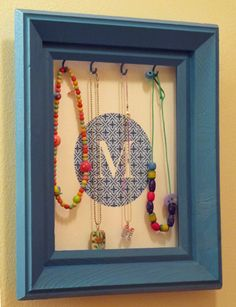 Frame Jewelry Organizer for Kids Room. Inspired by http://catonalimb.blogspot.com/2011/05/jewelry-display-frames-pottery-barn.html