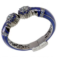 M.C.L by Matthew Campbell Laurenza: Sterling Silver Star chair leg hinge bangle hand-set with 1.49 ct ofIice Blue Mixed color Sapphires and 0.9 ct Blue Topazs with glitter blue enamel plated with black rhodium.