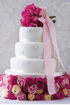 Romantic Pearl Fruit Wedding Cake (White icing) Product Code: 00580984 per kg) This sophisticated fruit cake covered in marzipan covered in white soft icing. Wedding Cake Pearls, Ivory Wedding Cake, Fruit Wedding Cake, Beautiful Wedding Cakes, Gorgeous Cakes, Pretty Cakes, Amazing Cakes, Ribbon Wedding, Elegant Wedding