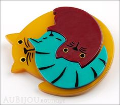 https://cdn.shopify.com/s/files/1/0472/7837/products/Marie-Christine_Pavone_Brooch_Cat_Puzzle_Orange_Burgundy_Turquoise_Galalith_Side_grande.jpeg?v=1436655806