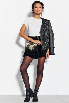 Tights, shorts, boots, white tee, and leather jacket