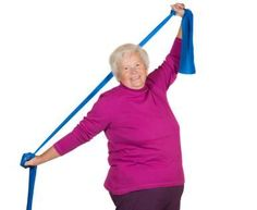 Strength Exercises for Low Back Spinal Arthritis: A senior woman exercises her back using a resistance band.