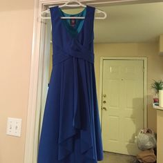 Vince Camuto blue dress Size 4. Worn once. Hits at knee with deep v and tie back Vince Camuto Dresses Midi