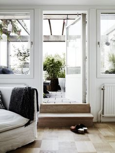 A Scandinavian Home In Black & White With Grey Tones. from living room directly to the backyard patio. via the style files, styling by Lotta Agaton / photography by Pia Ulin.