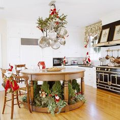 Look Up              Green garland accented with red bows turns a simple pot rack into a festive focal point for the kitchen