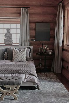 This is amazing. Something about the contrast of sophisticated grey and rough brown wood.