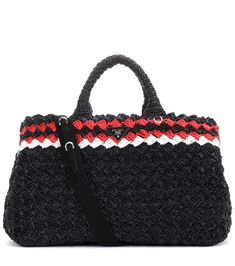 Prada - Raffia shopper - Prada's giant shopper is generously sized, making it perfect for daily essentials or day trips. Crafted in Italy from rustic raffia, this style comes in a dynamic black, red and white colourway and is punctuated by the label's iconic logo plaque. seen @ www.mytheresa.com