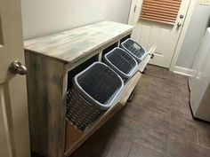 28 DIY Laundry Room Storage Center - The laundry room is an excellent place to experiment with design! Laundry rooms dont need to be boring. They may be hardworking, but that doesnt mea. by Joey Laundry Station, Laundry Center, Small Laundry, Laundry Folding Station, Laundry Bin, Laundry Hamper Cabinet, Laundry Baskets, Laundry Room Organization, Laundry Room Design