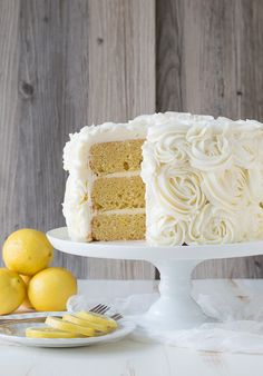 Lemon Layer Cake with Lemon Buttercream Rosettes. Rosettes look amazing and aren't that hard to frost. One of the gratest things to do with a basic tip. Desserts To Make, Lemon Desserts, Lemon Recipes, No Bake Desserts, Delicious Desserts, Lemon Layer Cakes, Layer Cake Recipes, Easy Cake Recipes, Lemon Birthday Cakes
