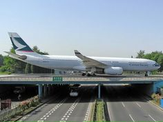 A Cathay Pacific Airbus crossing the bridge in Beijing. Commercial Plane, Commercial Aircraft, International Civil Aviation Organization, Private Plane, Private Jet, All Airlines, Airplane Photography, Jumbo Jet, Cathay Pacific