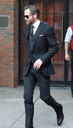 """""""Chris Pine heads out to 'Star Trek: Into Darkness' screening in New York City in a Ralph Lauren pinstripe suit."""""""