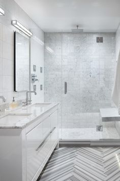 For minimal lovers, these clean lines and expert tiling will probably make your heart sing. Guinevere, the designer, laid the Carrara tile out in a grid (rather than an offset layout), making the space feel much more contemporary.