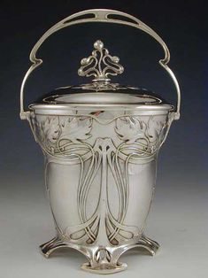 Silver-plate on pewter & brass biscuit barrel with art nouveau floral decoration. Germany - c.1906.