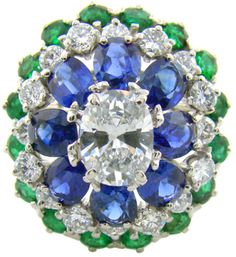 Oscar Heyman cocktail ring with a carat diamond surrounded by carats of additional diamonds and carats total of emeralds and sapphires. Via Diamonds in the Library. Art Deco Diamond, Art Deco Ring, Diamond Jewelry, Tanzanite Jewelry, Diamond Design, Thing 1, Platinum Engagement Rings, Rose Cut Diamond, Diamond Flower