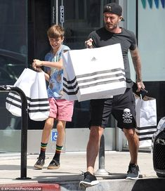Doting father: David Beckham, who turns 40 in May, was spotted enjoying some quality time ...