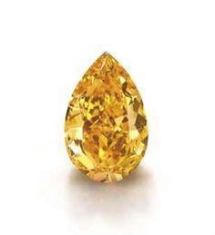 THE ORANGE: THE LARGEST FANCY VIVID ORANGE DIAMOND IN THE WORLD, 14.82 carats, VS1 clarity, sold for $35,543,804 ($2,398,367 per carat), Christie's Geneva November 2013