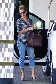 Eva Mendes was seen arriving at The London Hotel in LA in a casual plaid button-up shirt and cuffed ripped denim jeans. The actress tied her hair up with a scrunchie, tossed on some wedge heels and ...