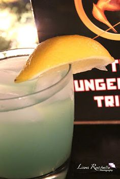 The District Five – Power (Cocktail) #HungerGames  1 ½ oz Citrus Vodka  ½ oz Blue Curacao  2 oz sour mix  1 can Red Bull or choice energy drink  lemon wedge garnish