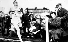 Roger Bannister breaks the four-minute mile, May 6 1954