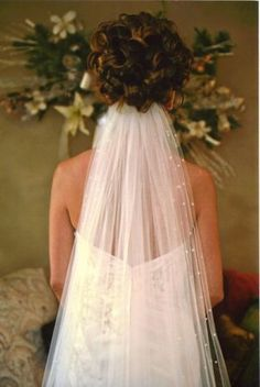 Updo...I think I like the veil from under the hair...