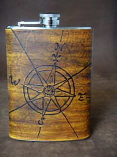 leather compass rose covered flask. love every aspect of this.