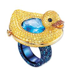 This exorbitantly priced ring would forever make me think of my kids...618 yellow diamonds, 66 amethysts, 132 tourmalines and 104 sapphires....I'd never be able to wear this but I love it!
