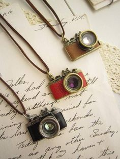 camera necklaces. LOVE the black one