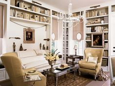 Rarely do shotgun cottages have formal entries. This monochromatic parlor acts as a space for welcoming and entertaining guests. (Photo: Robbie Caponetto, Roger Foley)
