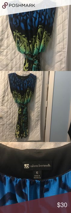 Dress size 6 Valerie Bertinelli Beautiful dress size 6 by Valerie Bertinelli could be used as casual or professional with a blazer shades of blues, greens yellow and black with open sides top lined. Worn once Dresses Midi