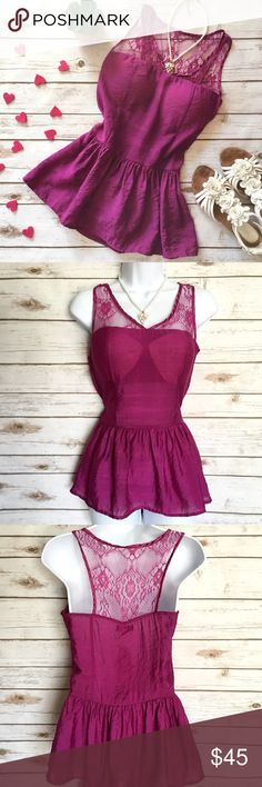Faisca Fuchsia Racer Back Peplum Top with Lace Has loops to be worn with a satin sash which is still attached to the label. Has side zipper and padded bra cups. Wonderful shiny material made from 84% cotton and 16% polyester. Size S, measures 16 inches across the bust, 14 inches at the waist, and about 25 inches in length. Faisca Tops