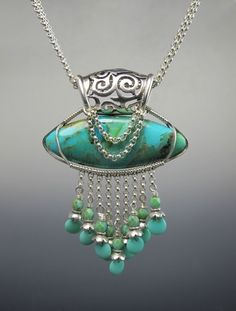 blue and green pendant set in silver