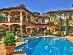 This Tuscan Estate's backyard is highlighted by a sparkling pool and spa with Tuscan accents and architectural features. 5252 Amestoy Ave | Amestoy Estates