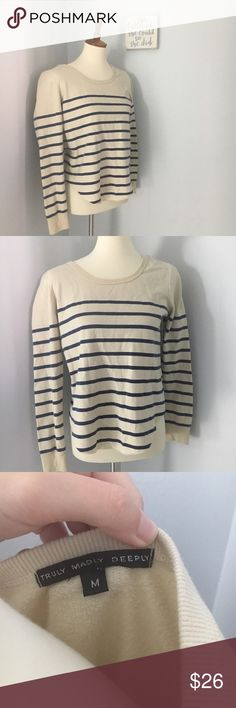 Truly madly deeply cropped sweater sweatshirt Perfect condition! A little cropped. 18 inch bust and 21 inch length. Can fit a small. No trades. E101 Urban Outfitters Tops Sweatshirts & Hoodies