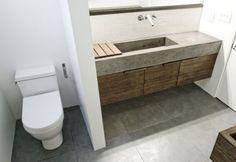 Master 1 Bath: cast concrete sink + wood cabinets, except 2 faucets